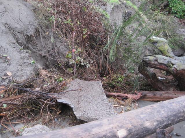 concrete slab that slide down the bank