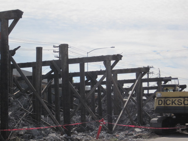 Alaskan Way Viaduct removal.  Old timbers under a modern road.