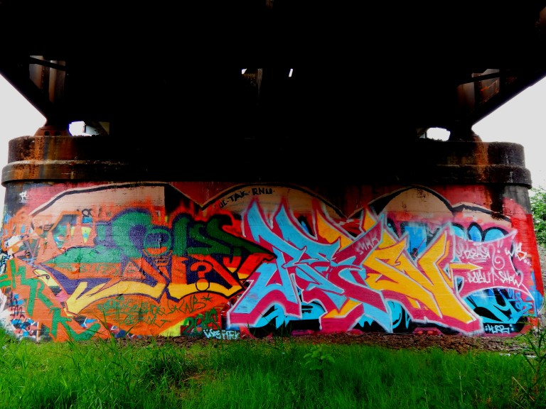 Graffiti under the RR tracks over Black River