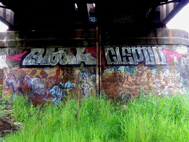 Bridge painted up under RR tracks