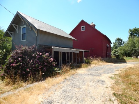 Red Barn behind old House