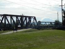 Railroad and trail bridge cross river at trail end