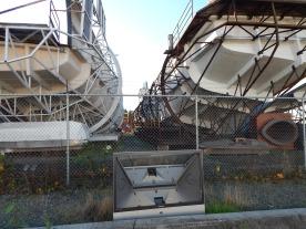 Boats & dead TV at back of boat yard.
