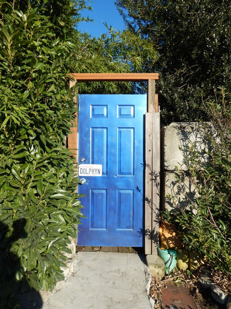 The blue door in the middle of industry