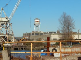 Big pile of rusty things with old crane & water tower