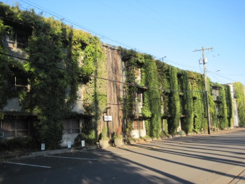 Gear Works building with greenery all over it