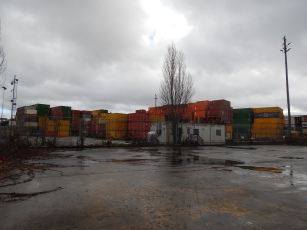 Close to river but container stack in way
