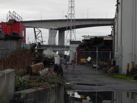 T-7 behind buildings on water - West Seattle Bridge in background