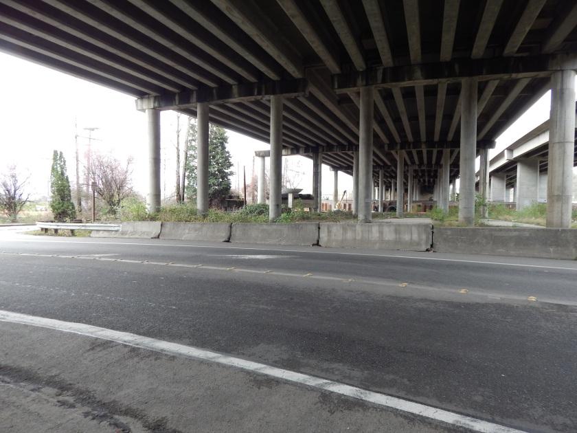 Freeway over old Longacres entrance unit and building slab